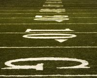 Football yardlines. Abstract shot of football field starting with the goaline. could portray going the distance to win in competition Royalty Free Stock Images