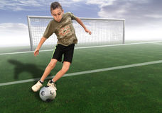 Football3. Young boy playing football stock photo
