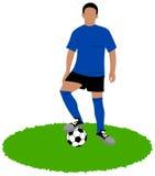 Footballer avec une boule au pied sur l'herbe Image stock