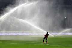 Footballer being sprayed Royalty Free Stock Photography