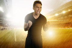 Footballer celebrating his victory Stock Image