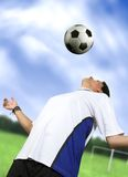 Footballer chesting the ball Royalty Free Stock Image
