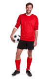 Footballer cut out on white. Photo of a footballer or soccer player cut out on a white background royalty free stock image
