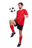Footballer cut out on white Royalty Free Stock Image