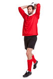 Footballer cut out on white. Photo of a footballer or soccer player cut out on a white background stock images