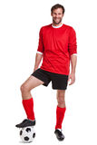 Footballer cut out on white. Photo of a footballer or soccer player cut out on a white background stock photography