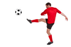 Footballer cut out on white. Photo of a footballer or soccer player cut out on a white background royalty free stock photography