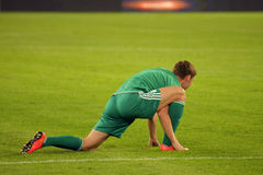 Footballer doing stretching Stock Image
