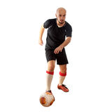 Footballer dribbles on white background Stock Photography