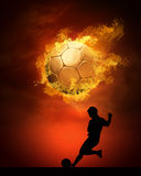 Footballer  in fires Stock Images