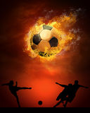 Footballer  in fires Stock Photo