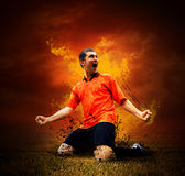 Footballer  in fires Royalty Free Stock Images