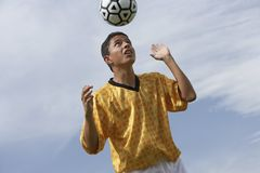 Footballer Heading The Ball Royalty Free Stock Images