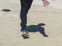 Footballer and his shadow on the ground Stock Photo