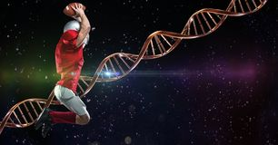 Footballer jumping in the space with dna chain behind him and green and pink lights. Digital composite of footballer jumping in the space with dna chain behind Stock Photo