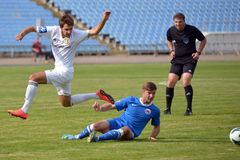 Footballer jumps his opponent Royalty Free Stock Images