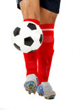 Footballer legs playing with a ball Stock Images