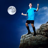 Footballer at night Stock Photos