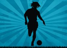 Footballer silhouette. Very powerful silhouette of football player on blue background Royalty Free Stock Image