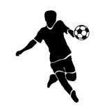 Footballer silhouette. Black football player outline with a ball, running and scoring goal, isolated on white background Royalty Free Stock Image