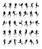 Footballer silhouettes. Set of football or soccer players in action silhouettes, reflected on white background Royalty Free Stock Image