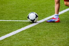 Footballer with a soccer ball Stock Images