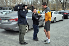 Footballer speaking with reporters Royalty Free Stock Photo
