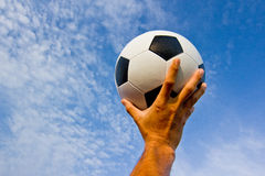 Footballer throwing a football Stock Image