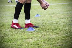 Footballer training. A footballer warming up before a match or training in a football training session royalty free stock photography