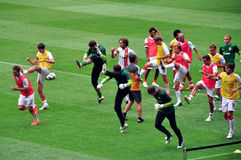 Footballers FC Shakhtar warm up on the field Stock Photo