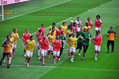 Footballers make a run on the field top view Stock Image