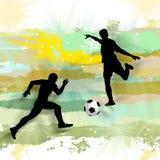 Footballers play football. Stock Photos