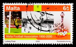 Footballers and trophy, Sporting Events 2000 serie, circa 2000. MOSCOW, RUSSIA - OCTOBER 3, 2017: A stamp printed in Malta shows Footballers and trophy, Sporting Royalty Free Stock Photography