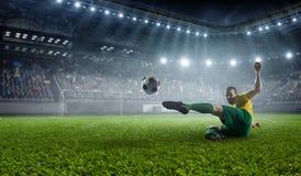 Footballeur au stade Media mélangé Photo stock