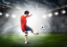 Footballeur avec la bille Photo libre de droits