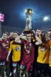 Footballeur avec la célébration d'or de bille Photos libres de droits