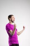 Footballeur dans le studio de selebrate d'isolement par chemise Images libres de droits