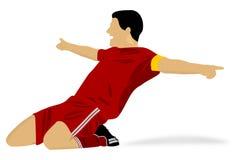 Footballeur heureux célébrant un but Photographie stock libre de droits