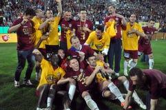 Footballeurs célébrant avec le champagne Photos libres de droits