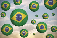 Footballs in brasil flag colours Royalty Free Stock Photo