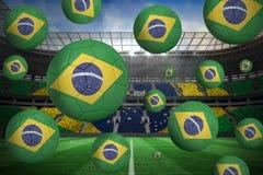 Footballs in brasil flag colours. Against large football stadium with brasilian fans royalty free illustration