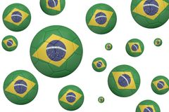 Footballs in brasil flag colours Stock Images