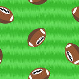 Footballs on field seamless pattern Stock Photography