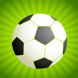 Footballs on a green background Stock Photography