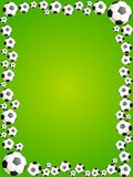 Footballs on a green background Royalty Free Stock Image