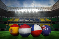 Footballs in group b colours for world cup Stock Images