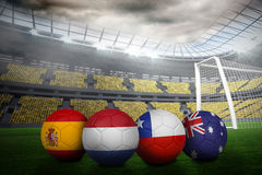 Footballs in group b colours for world cup Royalty Free Stock Images