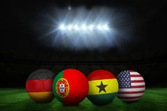 Footballs in group g colours for world cup Stock Photo