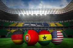 Footballs in group g colours for world cup Royalty Free Stock Images