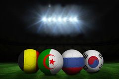 Footballs in group h colours for world cup Royalty Free Stock Photography